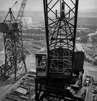 Bethlehem-Fairfield shipyards, Baltimore, Maryland. A crane operator high above the yard
