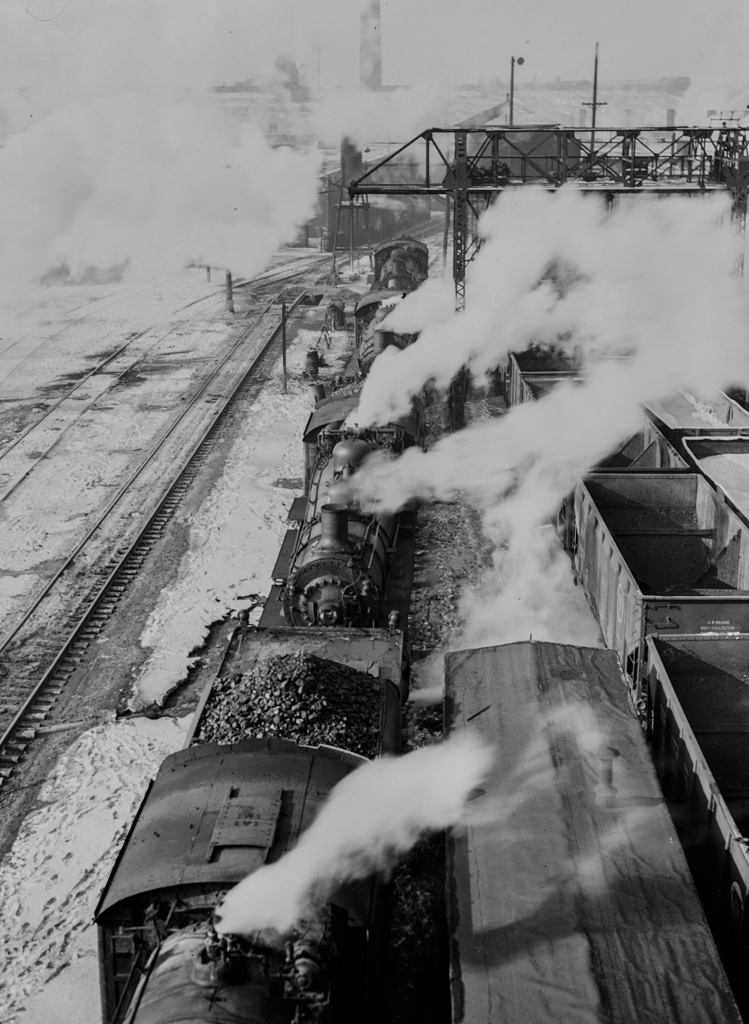 Chicago, Illinois. Locomotives lined up for coal, sand and water at the coaling station in the yard of the Chicago and Northwestern Railroad