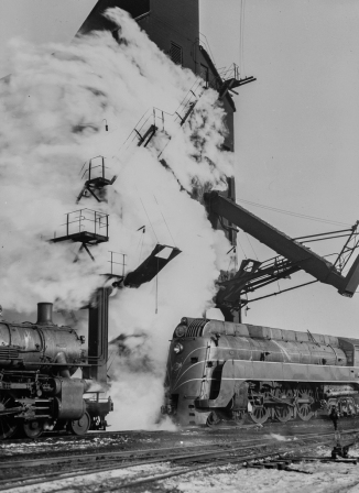 Chicago, Illinois. One of the Chicago and Northwestern Railroad's '400' fleet of locomotives lined up for coal and water at a coaling station