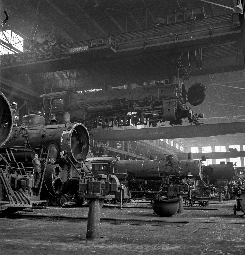 Albuquerque, New Mexico. An engine being carried to another part of the Atchison, Topeka and Santa Fe Railroad shops to be wheeled