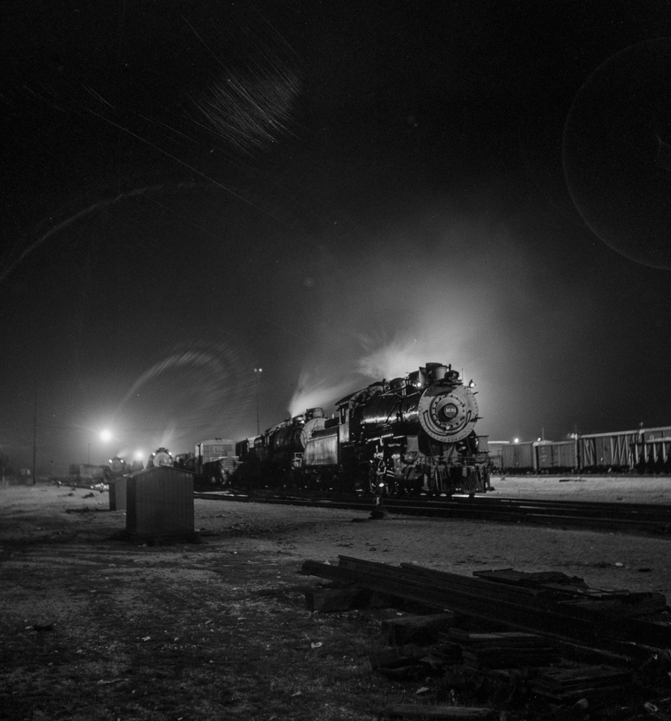 Barstow, California. A view of the Atchison, Topeka and Santa Fe Railroad yard at night