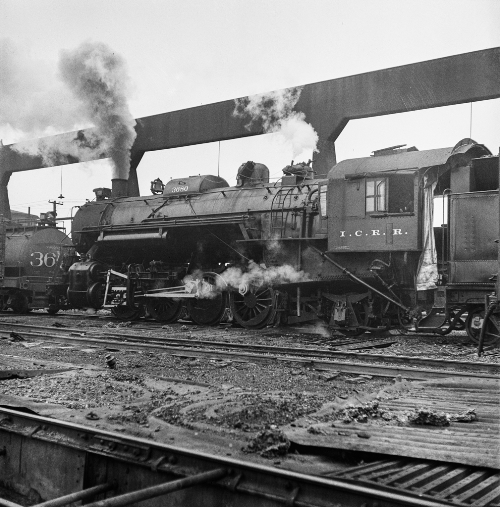Chicago, Illinois. Locomotive taking on sand at an Illinois Central Railroad yard, before going out on the road