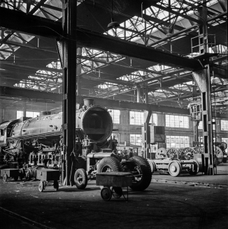 Chicago, Illinois. Locomotives in for repair at the roundhouse at an Illinois railroad yard