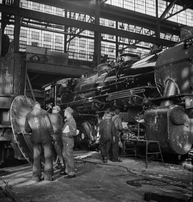 Chicago, Illinois. Working on a locomotive at the Chicago and Northwestern Railroad repair shop 4