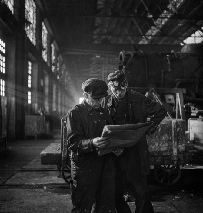Chicago, Illinois. Workmen studying blueprints in the Chicago and Northwestern repair shops