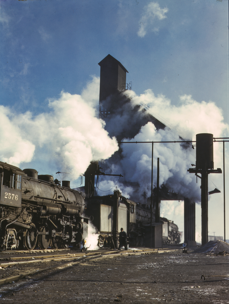 Locomotives over the ash pit at the roundhouse and coaling station at the Chicago and Northwestern Railroad yards, Chicago, Ill