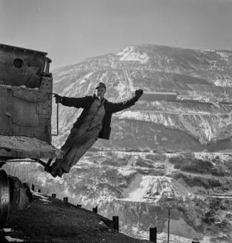 Utah Copper -Bingham Mine. Brakeman of an ore train at the open-pit mining operations of Utah Copper Company, at Bingham Canyon, Utah