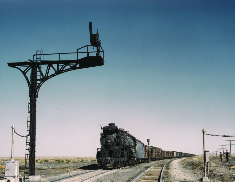 West bound Santa Fe R.R. freight train waiting in a siding to meet an east bound train, Ricardo, New Mexico