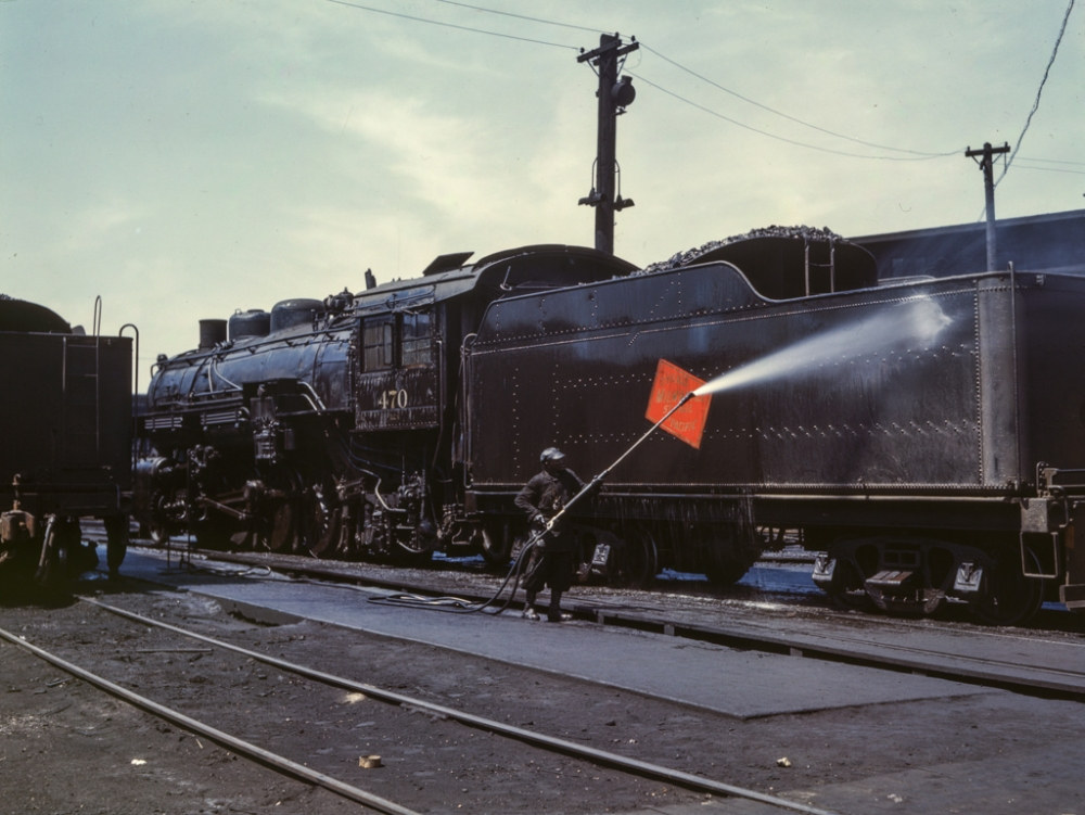 Cleaning an engine near the roundhouse, C. M. St. P. & P. R.R., Bensenville, Il