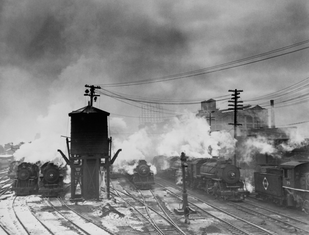 Locomotive and a watertower at the Erie Railroad yards, Jersey City, N.J-Edit