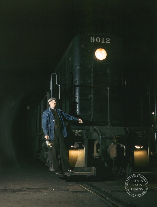 Illinois Central R.R., Chicago, Ill. Vernon Brower, riding the foot board of a diesel switch engine at the South Water Street freight terminal